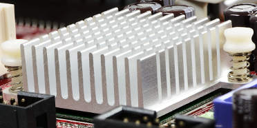 Extruded aluminum heatsink on a red printed circuit board