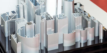 Various aluminum profiles sitting on a stand for display
