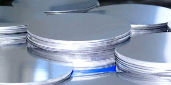 Aluminum circle blanks in a pile