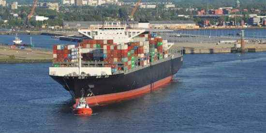 Cargo ship loaded with containers on the water