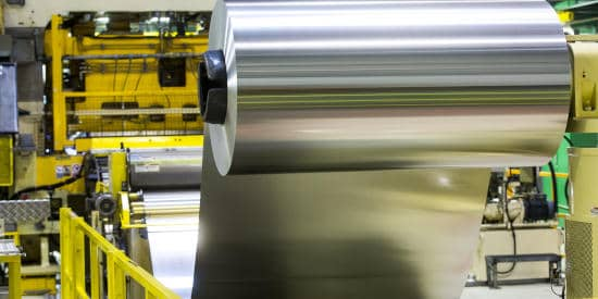 Rolled aluminum products being made in the factory