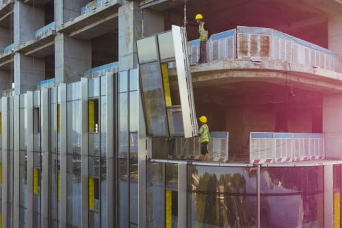 Aluminum curtain wall being installed on a building