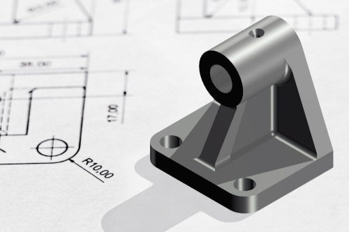Aluminum vs. Steel: A metal part sitting on top of a part drawing